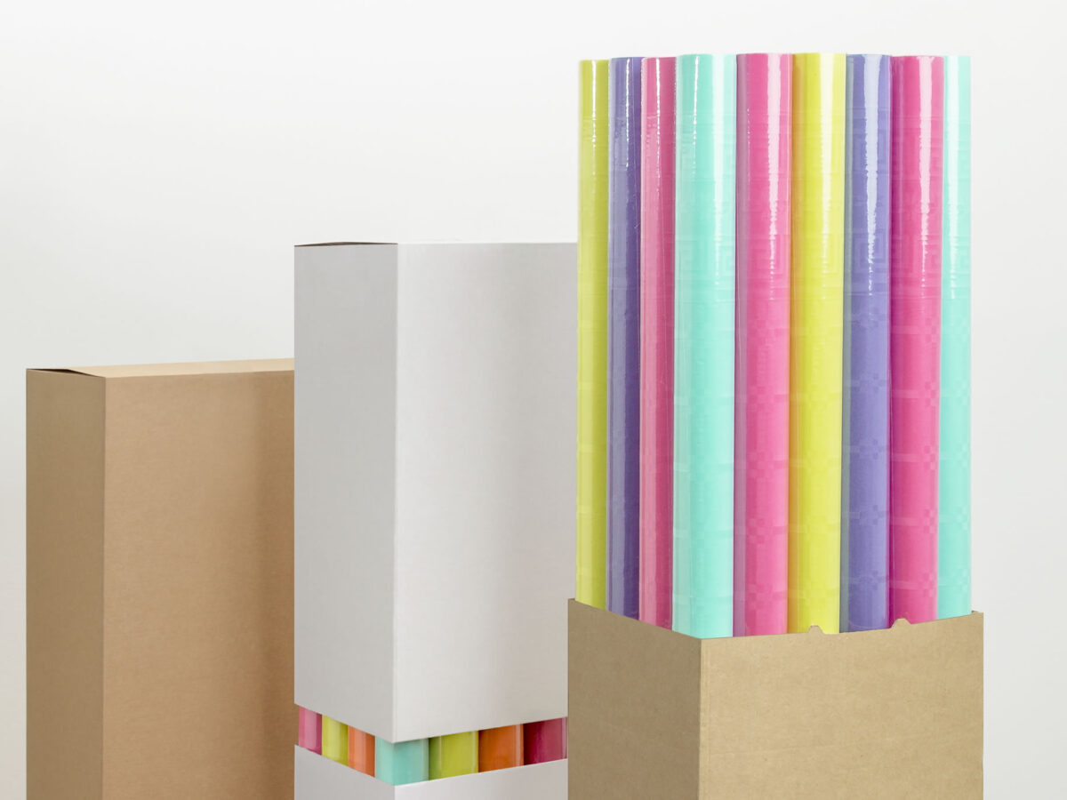 Assorted boxes with paper tablecloth rolls: lots of colours in a space-saving solution